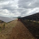 Harrowing and managing the vegetation between solar panels