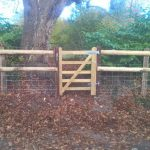 Creosoted post and rail and 2 new gates in Potterne