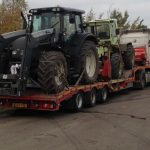 2 Tractors on a trailer, arriving on a job