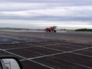 Treating moss and algae on a military airfield