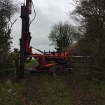 Fifteen feet long telegraph pole for a gate post being driven in to hang a gate on at Poulshot