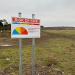 Erecting 38 warning signs around Salisbury Plain