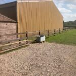 Plastic Fence on Creosote posts for equestrian yard