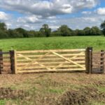Wooden farm gate and netting fence near Devizes